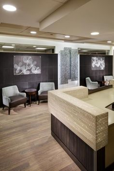 The seating area in the clinical suite is near a care team center and centrally located in relation to the exam rooms. Photo: Denmarsh Photography Inc.