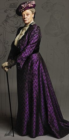 This outfit was made for Dame Maggie Smith as Violet Crawley, Dowager Countess of Grantham in Downton Abbey. The fabric was created by reproducing an Edwardian print onto silk. The design was based on a jacket from the era. Downton Abbey Costumes, Downton Abbey Fashion, Downton Abbey Characters, New Frock, Lady Violet, Dowager Countess, Moda Retro, Gentlemans Club, Fashion Mode