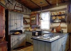 Old Cabin Kitchen...love all the old cupboards & shelves. #PrimitiveKitchen