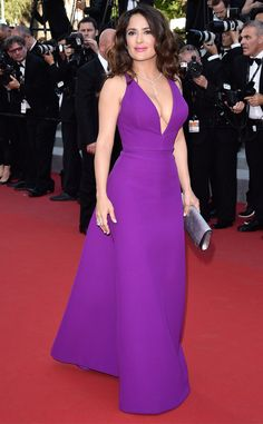 2015 Cannes: Salma Hayek is wearing a purple Gucci gown with a deep V neckline. WOW Salma stuns in purple! I adore the color and it fits her perfectly. I have no clue why but E! called the color of the gown magenta but I see purple not magenta. What do you think: Purple or Magenta?