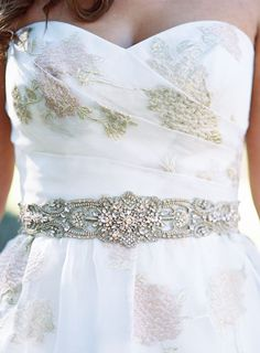 Pretty jeweled belt: Photography : Jen Wojcik Photography Read More on SMP: http://www.stylemepretty.com/california-weddings/vista-california/2016/06/17/a-monet-inspired-colored-palette-vintage-details-bring-the-south-of-france-to-southern-california/