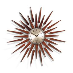 This retro inspired wall clock has a fabulous sunburst of varnished wood out from a brass-effect face. A popular design seen first in the 1970s, this style of clock will continue to be a timeless addition to any room.