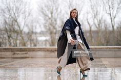 Landiana Cerciu wears a padded long poncho coat, a white dress, a. Turquoise Shoes, Poncho Coat, Beige Skirt, Image Now, Women Wear, White Dress, How To Wear, Outfits, Dresses