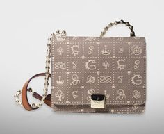 Love this Lancel Dalidol bag with the bicycle chain strap