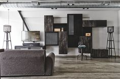 This edgy five- room HDB flat has cool charcoal tones, combined with metallic features, to create a space that has a full-on industrial feel.