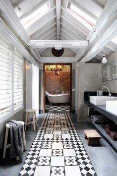 Modern Country Chic Bathroom...love how the patterned tile, designed to look like a carpet runner, draws your eye to the room at the end...the beautiful white bathtub & copper colored walls.