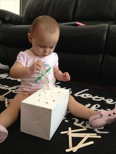 Box + popsicle sticks = 30 minutes of play for your 1 year old! These are great for fine motor skills development. Box + popsicle sticks = 30 minutes of play for your 1 year old! These are great for fine motor skills development. Activities For 1 Year Olds, Toddler Learning Activities, Baby Learning, Infant Activities, Preschool Activities, Indoor Activities For Toddlers, Toddler Play, Baby Play, Baby Toys