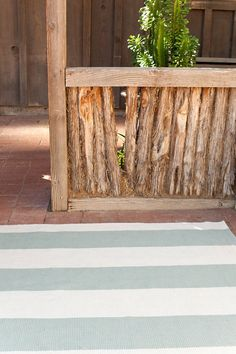 """Our woven cotton area rugs are so adaptable they make themselves at home in any room. Constructed using a hand loomed flat weave in durable 100% cotton, these rugs are lightweight, reversible and affordable.   • Stripes run the length of the rug and are 8"""" wide"""