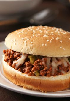 Pizza Sloppy Joes - Swap out the crust for soft hamburger buns, and you've got a tasty pizza-inspired version of sloppy joes with red sauce and mozzarella cheese.
