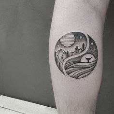 A simple yet beautiful looking Yin Yang tattoo. The elements are separated and on one side the mountains and land are depicted while the other half is filled with water and aquatic life forms.