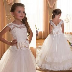 The flower girl dress ivory which match the flowers-first communion dresses for girls scoop backless with appliques and bowtulle ball gown pageant dresses for little girls is offered in hot_sales_dress and on DHgate.com flower girl dress pattern along with flower girl dresses for babies are on sale, too.