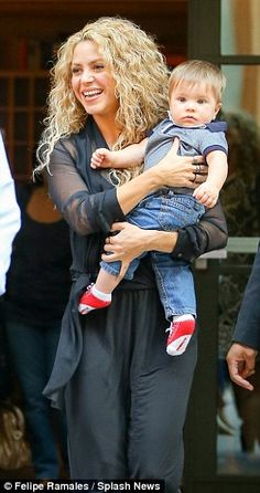 Proud mama: Shakira and her son Sasha PiquÈ Mebarak looked happy as they left their hotel ...