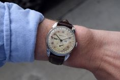 "A beautiful, stainless steel Triple Date timepiece retailed in the 1940s by Brock and Company with a case and movement produced by Movado. This example features a two-tone patinated dial, with raised Arabic numerals and a 34mm wide case. Brock and Company was a prominent jewelry firm founded in the early 1900s in Los Angeles in the building now known as ""Seven Grand"". (Store Inventory # 9206, listed at $1750). #movado #brockandco #vintage #watches #patina #tripledate #calendar #watch #stawc"