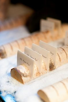 Birch logs for escort cards with snow sprinkled around. A perfect fit for the mountain weddings!