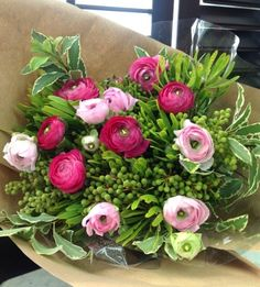 This unique bouquet features a mix of deep pink and sweet pink ranunculuses, wrapped in brown Kraft paper and tied with dark pink cloth ribbons. You won't find this anywhere else. For quirky girls only.