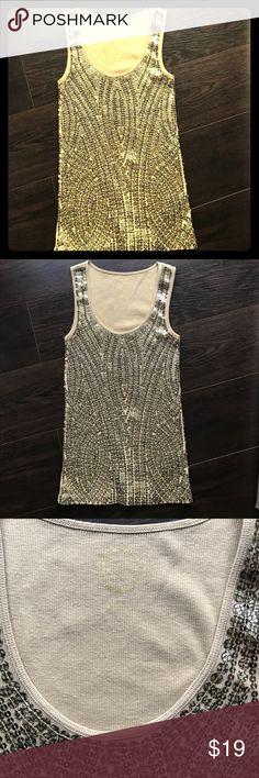 Michael Kors gold sequined tank - xs Michael Kors gold sequined tank - xs worn once. No damage or wear. Gold patterned sequined on a tan tank. Michael Kors Tops Tank Tops