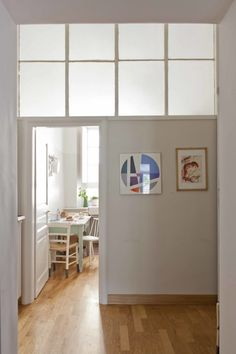 The passage into the kitchen, where architectural glass forms the top half of the dividing wall. Bedroom Divider, Glass Room Divider, Room Divider Walls, Room Divider Screen, Room Decor Bedroom, Room Dividers, Clerestory Windows, Transom Windows, Interior Windows