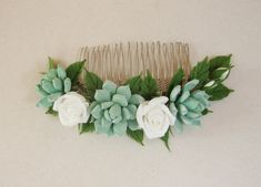 Check out this item in my Etsy shop https://www.etsy.com/listing/384662646/bridal-succulent-hair-comb-succulent