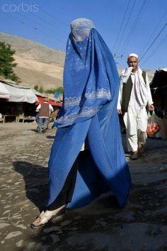 Woman wearing a burka and shopping in the bazaar in Faizabad, Badakhshan province, Afghanistan.