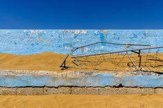 ripping sicilian palette 1 - a wall on a beach near syracuse in italy