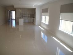 Polished Grey Porcelain Floor; like the combo of this floor with the glossy white cabinets