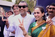 BJP candidate and actor Paresh Rawal who won from Ahmedabad East with his wife outside a counting centre in the city. ■ Photo: PTI