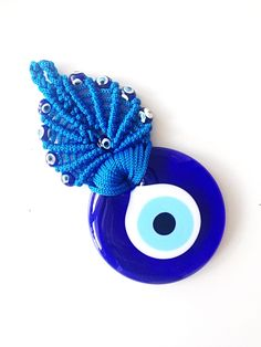 A personal favourite from my Etsy shop https://www.etsy.com/listing/278475766/evil-eye-wall-hanging-blue-macrame-wall