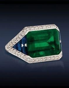 Emerald cut Emerald with Calibre Cut Sapphires.