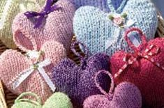 Cute Christmas decorations when done in festive colours- Pattern at http://www.goodtoknow.co.uk/family/440218/Heart-knitting-pattern