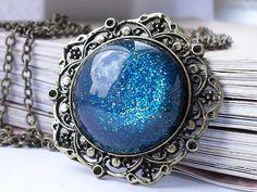 Blue sparkling resin galaxy brass necklace