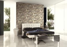 Layered stone wallpaper in a modern bedroom with white bed. From Wallquest's collection Structure. Industrial inspired wallpaper.