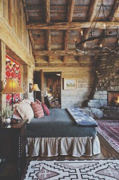 Cozy, Beautiful, Rustic Log Cabin Bedroom With An Amazing Ceiling Light And  Stone Fireplace.