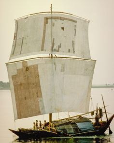 A barge hauling cargo along the river Ganges in the delta of Bangladesh needs both sails and oars to head upstream. The sail is sewn from recycled burlap bags. Photo from my book #VanishingAsia #Ganges #Bangladesh