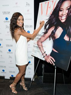 A radiant Gabrielle Union signs her Vegas magazine cover at the mag's 11 year anniversary event.