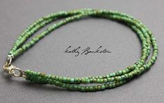 Shiny antiqued turquoise green seed bead bracelet. Three strands of beautiful, delicate, tiny beads. This is such a beautiful color! The seed beads are turquoise green in color but they have a hybrid
