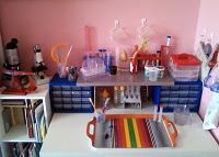 science table, stocked with microscopes, test tubes, and books for experimenting