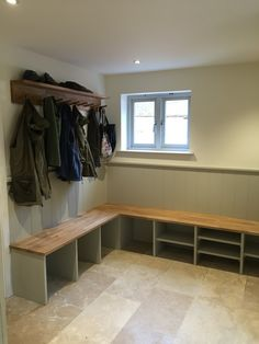 Boot room, with coat racks, shoe and welly storage oak topped bench seat