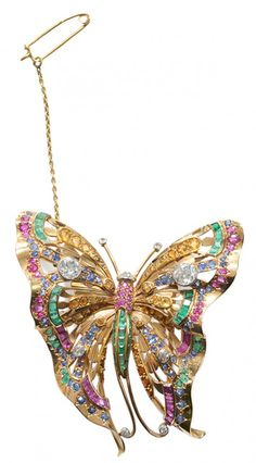 18 Kt. Butterfly Brooch with Diamonds.Sapphires, Rubies and Emeralds two Old European-cut, four round full-cut, faceted diamonds, total diamond weight 1.52 cts., color I-J, clarity SI 1-2, accented with blue and yellow sapphires, rubies and emeralds, 18 kt. yellow gold mount with double-pin back,