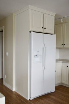 Boxing in Fridge with Cabinetry - Momplex Vanilla Kitchen - Ana White USE THE wood we got and buy a cabinet or buy a white end piece and buy a white cabinet Diy Projects Kitchen Cabinets, Diy Kitchen, Kitchen Furniture, Diy Furniture, Furniture Stores, Furniture Dolly, Furniture Outlet, Cabinet Furniture, Discount Furniture