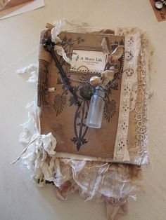 altered book by tarnished and tattered. I could put some forget-me-not seeds in the vial