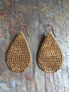 A personal favorite from my Etsy shop https://www.etsy.com/listing/498708308/gold-hoop-statement-earrings