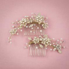 A set of delicate nature-inspired wedding hair combs artfully crafted with hand-painted gold leaves, dreamy pearls and rhinestone blooms.