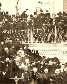 J. Wilkes Booth identified at Lincoln's Second Inauguration. The President stands delivering his speak (at pedestal). Booth is located top of crowd in the middle with top hat and famous mustache looking slightly down at Lincoln.  *s*