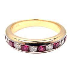 Platinum & Yellow Gold Diamond Ruby Lucida Band Ring by Tiffany & Co.  With 5 Diamonds VS1 clarity, G color total weight approximately 0.25ct and 6 rubies