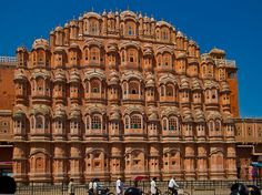 """Hawa Mahal stands upright as the entrance to the City Palace, Jaipur. An important landmark in the city, Hawa Mahal is an epitome of the Rajputana architecture. The splendid five-storey """"Palace of the Winds"""" is a blend of beauty and splendor much close to Rajasthan's culture. Maharaja Sawai Pratap Singh built Hawa Mahal in 1779. The pyramid shape of this ancient monument is a tourist attraction having 953 small windows."""