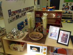 great shelf displays with frames and baskets