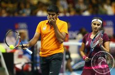 - #RohanBopanna and #SaniaMirza of the #IndianAces show their dejection against Kirsten Flipkens and Daniel Nestor of the Manila Mavericks during the Coca-Cola International Premier Tennis League at the Singapore Sports Hub on December 4, 2014 in Singapore. #IPTL