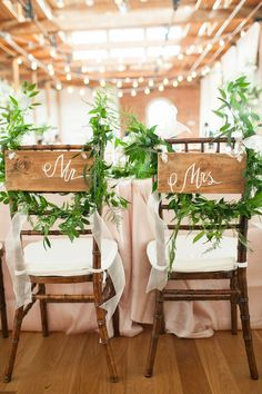 handpainted custom mr and mrs signs at industrial theme wedding reception