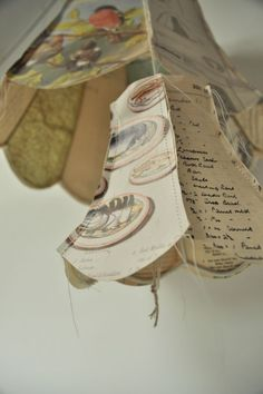 Paper lampshade handmade from vintage papers and maps by Jennifer Collier. Handmade stitched paper lampshade at madebyhandonline Jennifer Collier, Book Crafts, Paper Crafts, Paper Lampshade, Art Antique, Origami, Lamp Shades, Light Shades, Vintage Paper