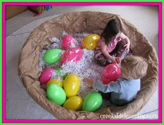 Use a kiddie pool to make a bird's nest. (I'm not sure where to get giant eggs - Amazon had a few, but pricey... could do paper mache eggs)